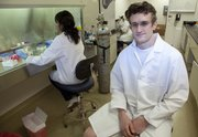"""Laird Forrest, assistant professor of pharmaceutical chemistry, works in stem cell research at the Simons Laboratories on Kansas University's West Campus. He says a ban during the Bush administration on embryonic stem cell research has, """"in its own backhanded way, been good because it has forced innovation in terms of looking at other stem cell systems."""""""