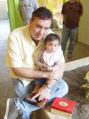 Wayne Elsey, founder of Soles4Souls, poses for a photo with a young recipient of shoes in Reynosa, Mexico, in this December 2007 photo. The organization has distributed more than 5 million pairs of shoes.