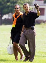 President Barack Obama and first lady Michelle Obama, arrive Saturday at Fort Lesley J. McNair from Camp David, Md., in Washington.