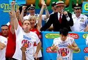 Joey Chestnut, left, of San Jose, Calif., defending champion of the Nathan's Famous July 4th Hot Dog Eating Contest, celebrates his victory, logging his third consecutive win with a world-record 68 franks over former champion Takeru Kobayashi of Nagano, Japan, July 4, 2009, in New York. A frank. A wiener. A hot dog. Call it what you will, but our nation can't get enough of them.