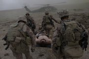 Medics attached to the 2nd Marine Expeditionary Brigade, 1st Battalion, 5th Marines, carry a Marine who was overcome by heat exhaustion Monday to a medical evacuation helicopter in the Nawa district of Afghanistan's Helmand province.