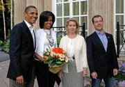 President Barack Obama, first lady Michelle Obama, Svetlana Medvedev and her husband, Russian President Dmitry Medvedev, pose Monday at the Gorki residence outside Moscow. The leaders pledged to reduce nuclear stockpiles by about a third on Monday.