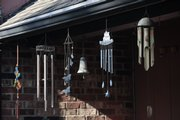 A collection of wind chimes hangs outside the home of Cindy Foster, a resident at Edgewood Homes, 1600 Haskell Ave.