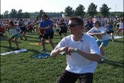 "Reporter Mark Boyle takes to the field at the recent ""Dog Days"" workout. Organizers declared it the ""World's Largest Community Workout"" with 2,766 attendees listed on the sign-up sheets."