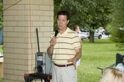 U.S. Sen. Sam Brownback, Republican candidate for the 2010 governor's race, speaks to about 150 people at a Leavenworth County Republican Party barbecue Saturday at VFW Park in Tonganoxie.