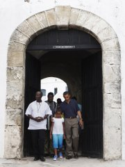 President Barack Obama walks with daughter Sasha during a tour of the Cape Coast Castle in Ghana on Saturday.