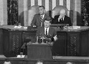 "President John F. Kennedy speaks in the House of Representatives before a joint session of Congress in Washington in this May 25, 1961, file photo. In the background are Vice President Lyndon B. Johnson, left, and House Speaker Sam Rayburn. During the address, Kennedy issued the challenge, ""I believe that this nation should commit itself to achieving the goal, before this decade is out, of landing a man on the Moon and returning him safely to the Earth."" The 40th anniversary of the Apollo 11 launch, which took U.S. astronauts to the moon, is Thursday."