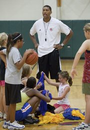 Former KU basketball player Wayne Simien works with girls in his Called to Greatness basketball camp Wednesday at Free State High school.