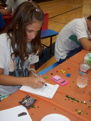 Domino Brewer, a sixth-grader at Langston Hughes School, participates in a financial camp sponsored by Meritrust Credit Union. The credit union sponsors the summer sessions to try to instill good money management habits at a young age.