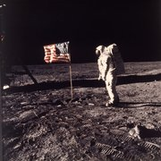 "In this July 20, 1969, file photo,  Astronaut Edwin E. ""Buzz"" Aldrin Jr.  poses by a U.S. flag on the moon during the Apollo 11 mission."