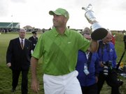 Stewart Cink holds up the trophy after winning a playoff to win the British Open.