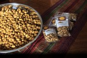 A large bowl of recently smoked nuts prepared by Kathy Prather awaits packaging. Prather's company, Nut Nation, sells roasted pistachios at several local stores, as well as outlets in other states.