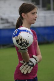 Traci Monahan, 12, of Lenexa, was one of many young girls to take to the soccer fields at Kansas University to practice their favorite sport.