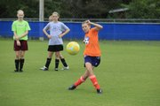 Heidi Hayen 13, of Topeka kicks a goal.