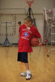 Austin Jamison, of Baldwin City, works on his ball-handling skills at Wayne Simien's basketball camp.