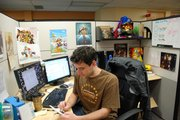 """Matt Cox works in his office in Seattle. The video game designer most recently developed """"Scribblenauts,"""" which debuts Sept. 15 and earned """"sleeper hit"""" status at the recent E3 (Electronic Entertainment Expo) trade show."""