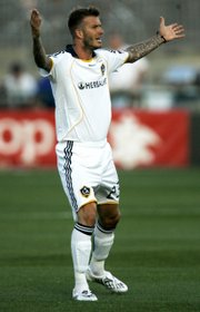 Los Angeles Galaxy midfielder David Beckham asks for a call from the officials during an MLS soccer game against the Kansas City Wizards. The teams played to a 1-all draw Saturday in Kansas City, Kan.