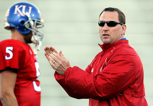 Former Kansas receivers coach David Beaty, right, will return to the KU coaching staff in 2011.