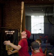 "Ottawa Post 60 player Dylan Nelson showcases his bat balancing ability while he and other teammates wait for their turn in the batting cage Tuesday, July 28, 2009. The players practiced Tuesday in an indoor batting facility they call ""the cave."""
