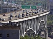 The Interstate-90 Innerbelt bridge is shown during rush hour Tuesday in Cleveland. Tens of thousands of the nation's worst bridges must wait for repairs because states are spending stimulus money on better spans or on easier projects like repaving roads, an Associated Press analysis shows.