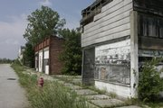 In this photo taken Wednesday, July 8, 2009, abandoned buildings line Main Steet in Picher, Okla.
