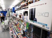 Sony Playstation 3 game consoles are seen on display at Yamada Denki electronics in Tokyo on Thursday. Sharp declines in game console sales for Nintendo and Sony are the latest symptoms of the video game industrys summer of slump. But for such a holiday-dependent business, a summer slump is still much better than a Christmas slump.