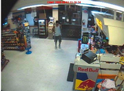 Lawrence police have released security camera images of the armed robbery at the Conoco, 2447 W. Sixth Street, Monday night.