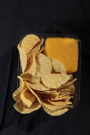 Nachos with cheese ($3)