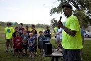 Former Jayhawk basketball player Darnell Jackson speaks to participants of the fifth-annual Red Dog Run shortly before the start of the race Saturday along the Kansas River levee.