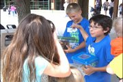 """ZooKeeper for a Day"" students Wyatt Davis and Christian Medina educate zoo patrons about the animals."