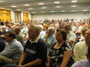 More than 200 people on Thursday filled a room at the Topeka-Shawnee County Public Library to attend health care meeting called by U.S. Rep. Todd Tiahrt, R-Goddard. Dozens more were seated in a spillover area. Tiahrt opposes plans by Democrats to reform health care system.
