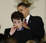 "President Barack Obama presents the 2009 Presidential Medal of Freedom to Billie Jean King, known for winning the ""Battle of the Sexes"" tennis match and championing gender equality issues, during ceremonies Wednesday at the White House in Washington."