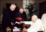 The Rev. Vincent Krische, left, then director of the St. Lawrence Catholic Campus Center, and Archbishop Emeritus James P. Keleher, of the Archdiocese of Kansas City in Kansas, meet with Pope John Paul II in his residence, the Apostolic Palace, in the Vatican City in this February 2005 photo.