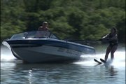 Boaters Brian Legg, driving, and Bryan Adriance, standing, help Tina Jinkens experience water-skiing.