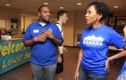 Cody Charles, left,  with KU's department of Student Housing, tells KU Chancellor Bernadette Gray-Little about move-in day on the hill Sunday.