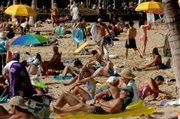 Visitors pack Waikiki Beach in Honolulu in this Feb. 1, 2006, file photo. Hawaii became the 50th state 50 years ago this week, helping transform an island economy dominated by sugar and pineapple fields into a vacation paradise for Americans.