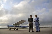 "Audrey Collins, 90, stands with flight Instructor Mark Miller outside the Wells Aircraft hanger at the Hutchinson Municipal Airport before flying her first airplane in this July 21 photo. Waldron Place, a Hutchinson assisted-living community, helps realize the dreams of its residents through ""person-centered activities."""