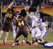 Kansas quarterback Todd Reesing heaves a pass over the Minnesota line as Jake Sharp (1) looks to make a block during the fourth quarter of the Insight Bowl in this photo from Dec. 31, 2008, at Sun Devil Stadium in Tempe, Ariz. Reesing and Sharp both return this season.