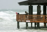 A pavilion that is normally on the beach is surrounded by water Monday as the effects of Tropical Storm Claudette are felt Monday in Destin, Fla.