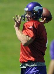 New Minnesota Vikings quarterback Brett Favre tosses a pass during practice Tuesday in Eden Prairie, Minn.