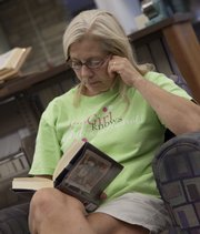 Terri Sohl of Lawrence was taking time some book reading time of the Lawrence Public Library.