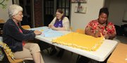 From left, Rachel Schmidt and Roxanne Hayden, along with La Tonya Johnson of the the women's support group at Lawrence Community Shelter, have started making baby blankets for children at Birthright of Lawrence and the Pregnancy Care Center.
