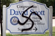 Signs vandalized with swastikas, like this one outside the office of Rep. David Scott, D-Ga., in Smyrna, Ga., have — along with other Nazi imagery, heckling and violent outbursts — contributed to a public atmosphere of anger across the country.