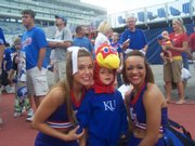 Miles McEachen takes a photo with KU cheerleaders at Fan Appreciation Day Wednesday, August 26, 2009.