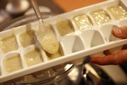 Finally, spoon the processed baby food into ice cube trays to be frozen and later thawed when desired.