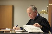 Judge Michael Malone looks over Lawrence city code in court Friday morning during a hearing with Club Axis and the city of Lawrence.