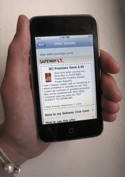 The Cellfire mobile coupon application for iPhone and iPod Touch is demonstrated Thursday in New York. Digital coupons don't need to be clipped to bring them to the store.