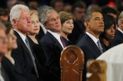 From left, Former President Bill Clinton, Secretary of State Hillary Clinton, former President George W. Bush, former first lady Laura Bush, President Barack Obama, and first lady Michelle Obama attend funeral services for U.S. Senator Edward Kennedy on Saturday at the Basilica of Our Lady of Perpetual Help in Boston.