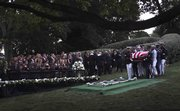 The Kennedy family gathers around the grave site as an Honor Guard carries the casket of Sen. Ted Kennedy on Saturday at Arlington National Cemetery, in Arlington, Va. Kennedy's remains will be buried alongside his slain brothers, John and Robert.