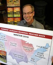 Peter Geiger, editor at the Farmers' Almanac, holds up a poster predicting an especially cold winter.